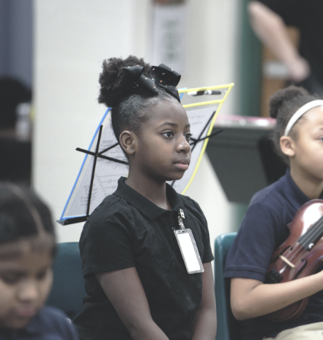 girl listening to conductor