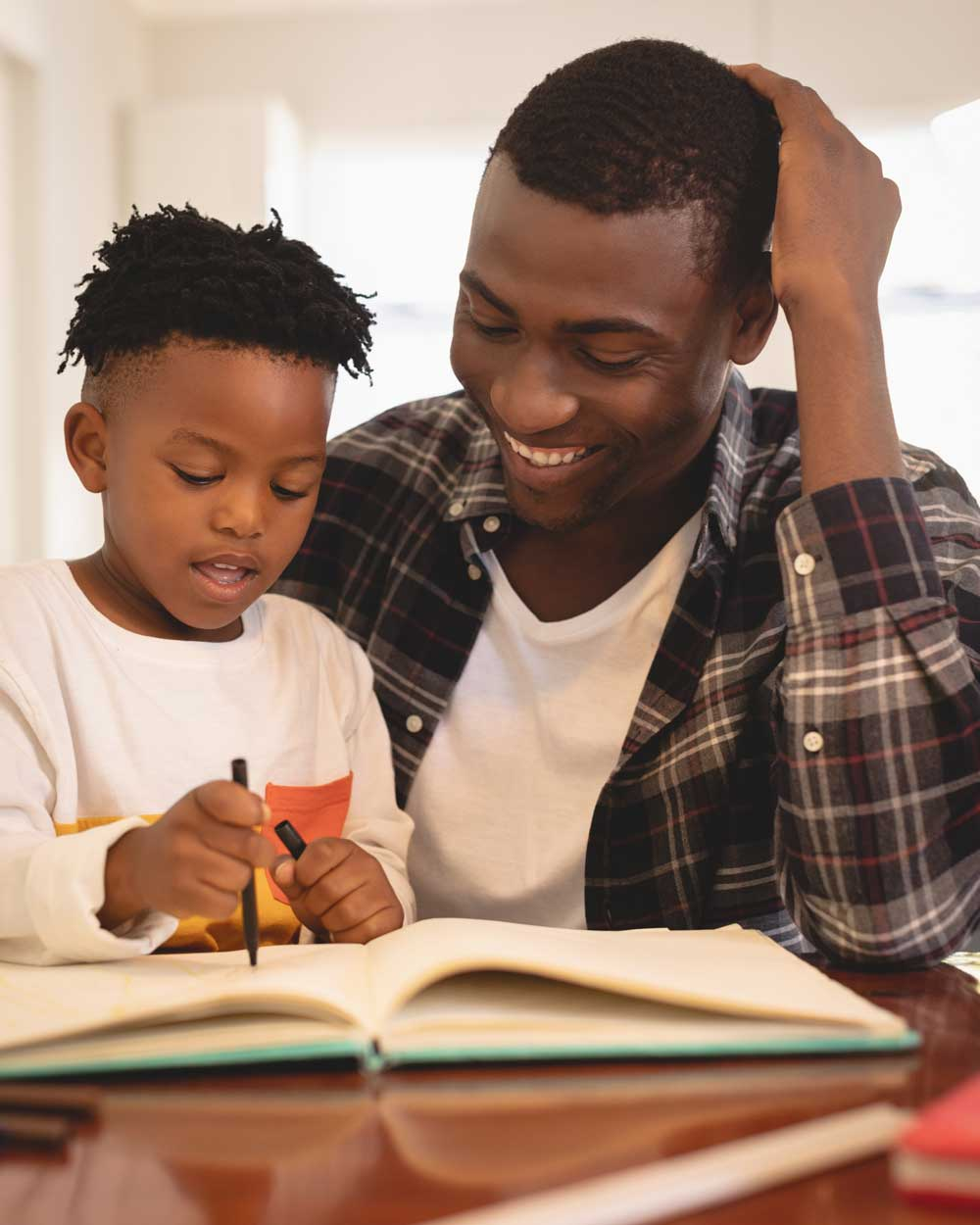 father reading with son